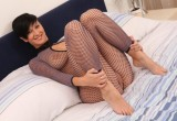 Free porn pics of Short dark haired girl in horny fishnet catsuit 1 of 30 pics