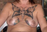 Free porn pics of breast and cunt tattoos  1 of 12 pics